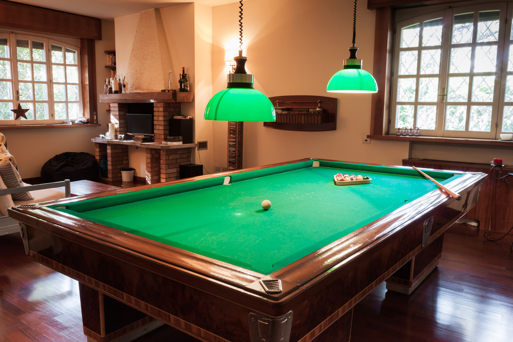 Pool Room Furniture Ideas image of small game room ideas The Green Lamps Complement The Pool Table Giving This Billiard Room A Chic Appearance The Polished Mahogany Floors Make A Bold Statement On Behalf Of The