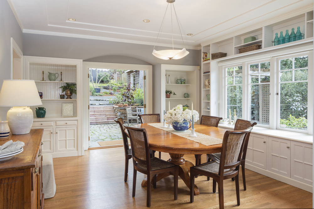 Open villa dining room with white trim and fixtures